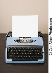 Still life of blank sheet of paper in an old fashioned typewriter.