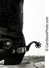 Old-fashioned western still life with old cowboy shoes ans spurs
