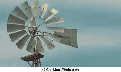 Old fashioned Windmill / Wind mill spinning in the wind. -...