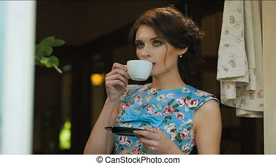 Old fashioned woman drinking tea - Beautiful young woman...