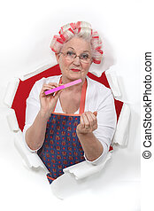 Old fashioned woman wearing hair rollers