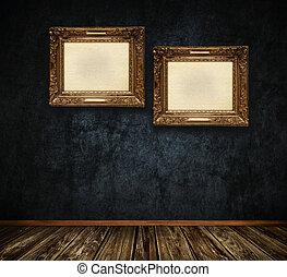 Old-fashioned wooden frame on dark grunge wall.