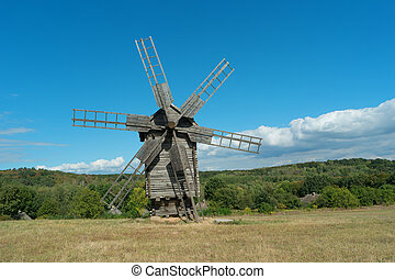 Old fashioned wooden wind mill.