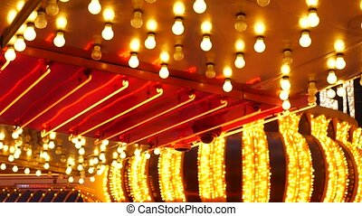 Old fasioned electric lamps blinking and glowing at night. Abstract close up of retro casino decoration shimmering in Las Vegas, USA. Illuminated vintage style bulbs glittering on Freemont street.