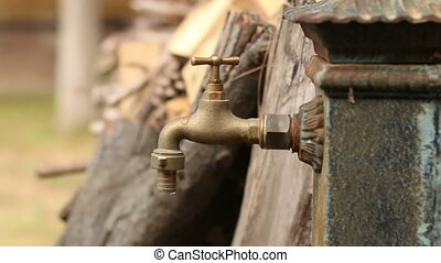 Old Faucet. Dripping Tap - Old faucet dripping. Iron...