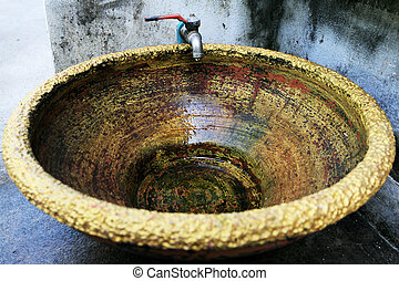 Old faucet with basin golden color.