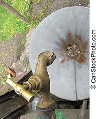 old faucet with water drop