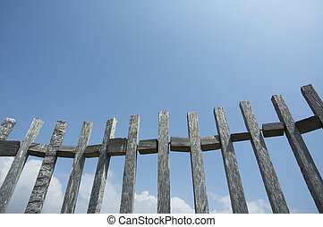 old fence against blue sky