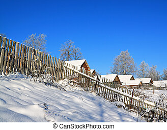old fence near snow village