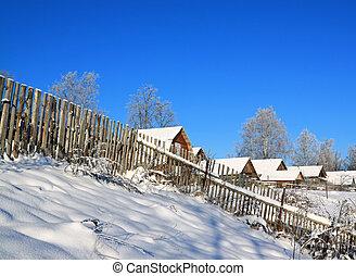 old fence near snow village