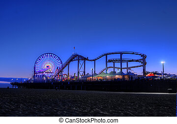 Old Ferris Wheel and Santa Monica Pier at Twilight in Santa Monica, California USA