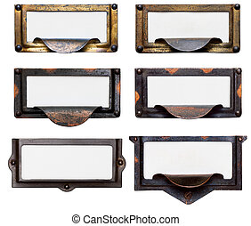 Collection of six old, tarnished brass file drawer label holders and drawer pulls with blank cards. Isolated on white. Includes clipping path.