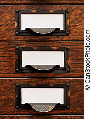 Old File Drawers With Blank Labels - Vertical stack of three...