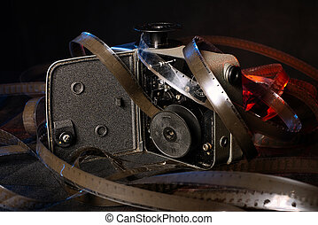 old film and the insides of the vintage camera on the table