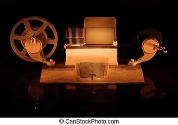 Old film editing machine - A old fashioned film editor shot...