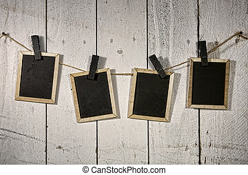Film Looking Chalkboards Hanging on a Rope Held By Clothespins
