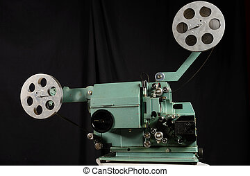 Old film projector on a black background