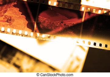 Old film strip and photos background - Grunge film strip...