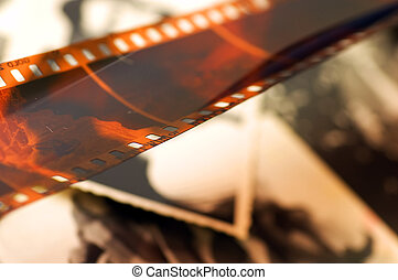 Old film strip and photos background - Grunge film strip...