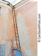 Old fire escape on a wall background