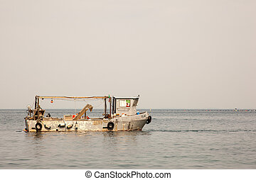 Old fisher boat in the Trieste sea
