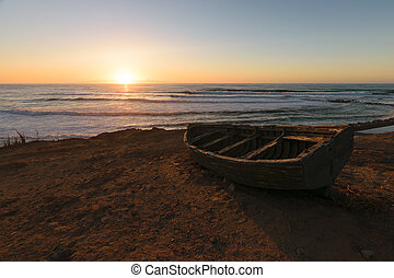 Old fisherman boat at sunset, Morocco