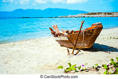 Old fisherman boat with anchor on the beach