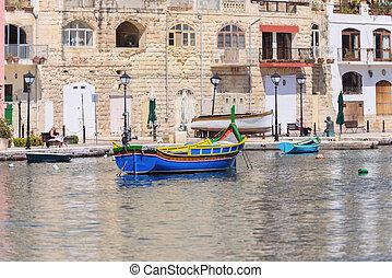 fishermen boat in Spinola bay at Malta
