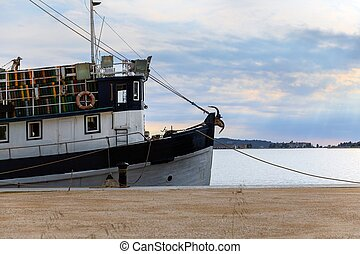 Old fishing boat anchored in the port