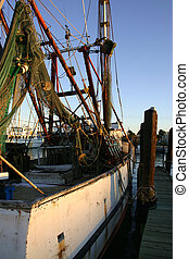 Old Fishing Boat Galveston - Old rusting fishing boat tied...