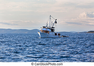 Old fishing boat in Adriatic sea - Old fishing boat in the...