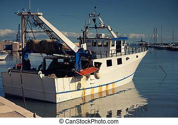 Old fishing boat in Bari, Italy.