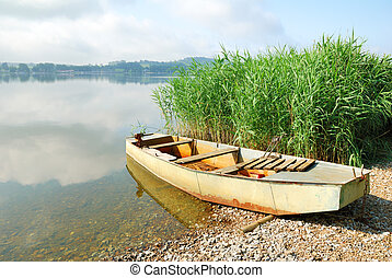 Old fishing boat on a lake shore