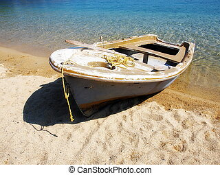 Old fishing boat on sand