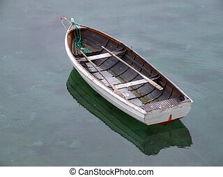 Old fishing boat on still water - Old fishing boat and its ...