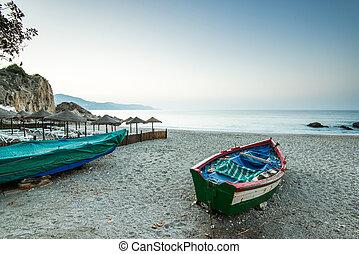 Old fishing boat on the beach in Nerja, Spain