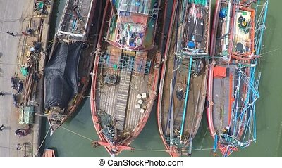 Old fishing boats, aerial video, view from above, Thailand