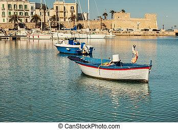 Old fishing boats in Bari, Italy.
