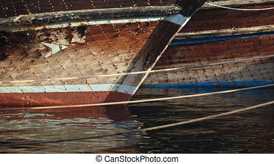 Old Fishing Boats Moored in the Dubai Harbor - Hulls of old,...