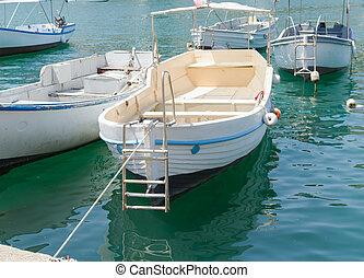 fishing boats near a pier