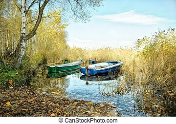 Old fishing boats on a lake's shore