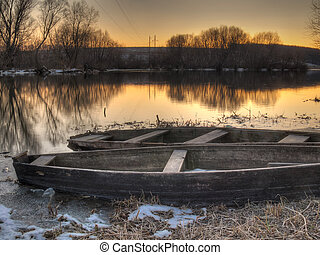 Old fishing boats on river