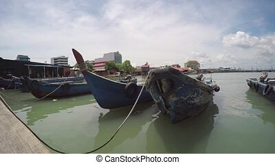Old Fishing Boats Tied to a Wooden Pier in Penang. FullHD...