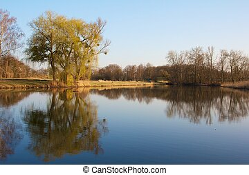 Old fishing hut with a wooden dock in the famous Rheinauen nature reserve at the River Rhine, Karlsruhe, Germany