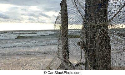 Old Fishing Net Hanging on Seaside - Old Fishing Net Hanging...