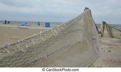 old fishing nets on sea beach