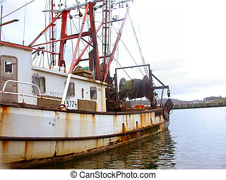 An old rusty fishing vessel docked at the Yaquina Bay Harbor in Newport, Oregon (Central Oregon Coast)