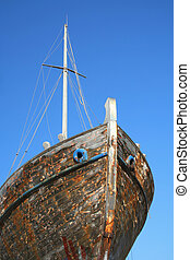 Old flaky ship and blue sky