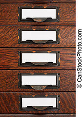 Old Flat File Drawers With Blank Labels - Vertical stack of...