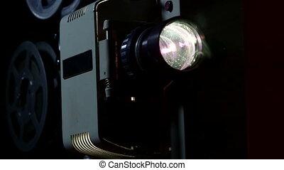 Old flickering movie projector showing film